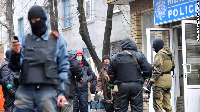 Caption:Pro-Russia protesters guard a barricade outside a regional police building seized by armed separatists in Slavyansk on April 13, 2014. Ukraine on Sunday launched an 'anti-terrorist operation' in the eastern town of Slavyansk, where pro-Russian gunmen have seized police and security services buildings, Interior Minister Arsen Avakov said. AFP PHOTO / GENYA SAVILOV (Photo credit should read GENYA SAVILOV/AFP/Getty Images)