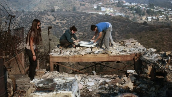 Family members rummage through the ruins of their home on April 13.