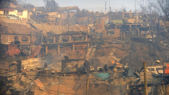 Homes that were consumed by the fire line a hillside on April 13.