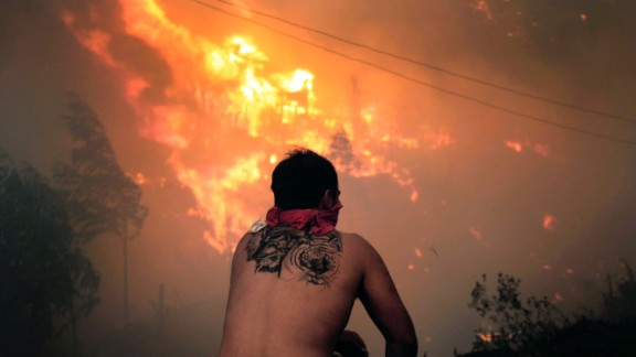 A man watches the flames on April 12.
