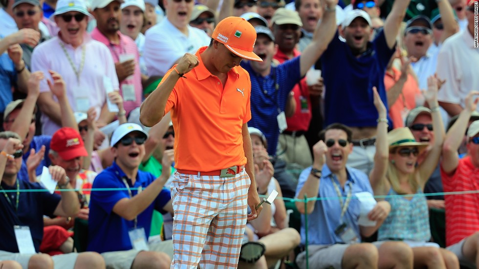 Resplendent in orange, Rickie Fowler milks the applause of the crowd after holing a monster putt on the ninth in the final round.