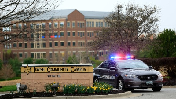A  police car is seen at the entrance of the Jewish Community Center after a deadly shooting on Sunday, April 13 in Overland Park, Kansas.