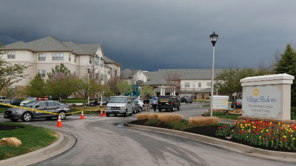 Investigators work the scene of a shooting at the Village Shalom Retirement Community in Leawood, Kansas, on April 13.