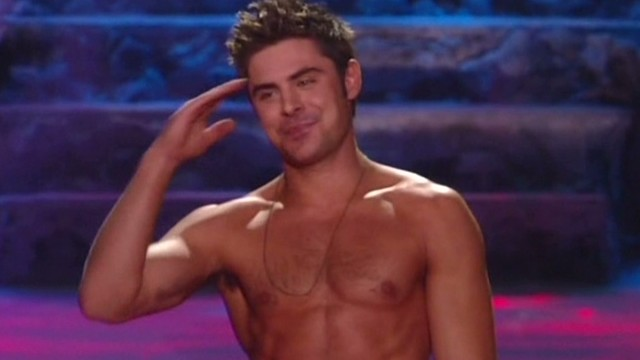 Zac Efron loses shirt at MTV awards