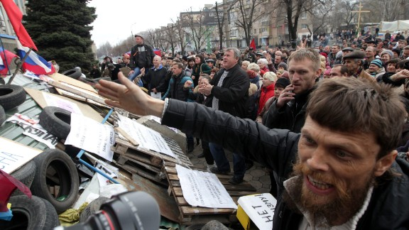 Pro-Russian supporters attend a rally in front of the security service building occupied by Pro-Russian activists in Lugansk, Ukraine, on Monday, April 14.