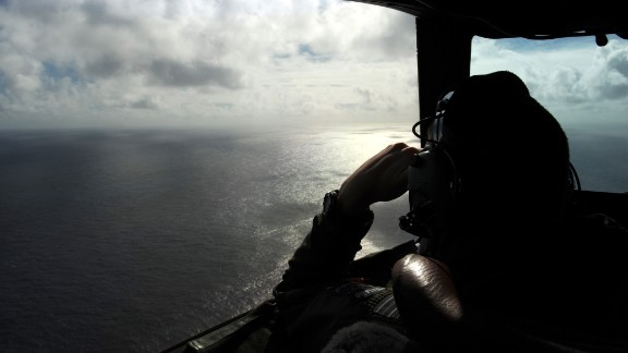 A member of the Royal New Zealand Air Force looks out of a window while searching for debris off the coast of western Australia on April 13, 2014.