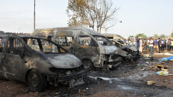 People gather at the site of a blast at the Nyanya Motor Park, about 16 kilometers (10 miles) from the center of Abuja, Nigeria, Monday, April 14, 2014.