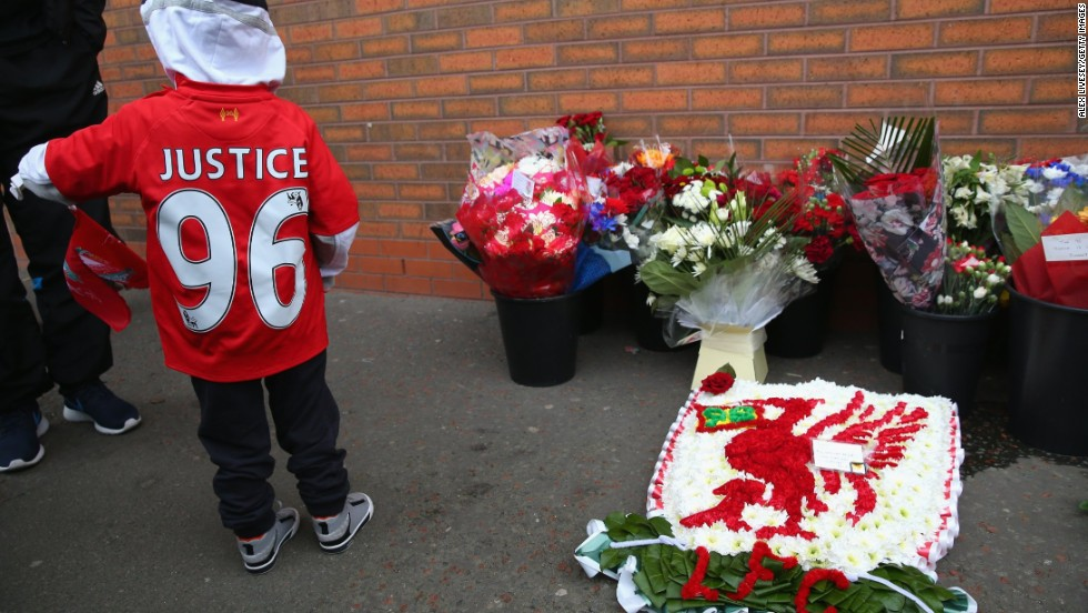 The young fan wears a shirt calling for justice for the 96 victims.