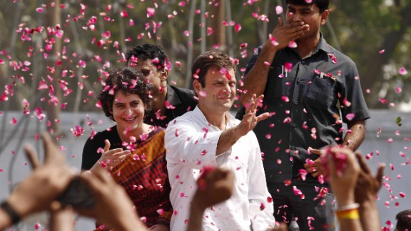 Rahul Gandhi, one of the leading candidates for prime minister, waves to supporters in Amethi, India, as he arrives to file his nomination on April 12.