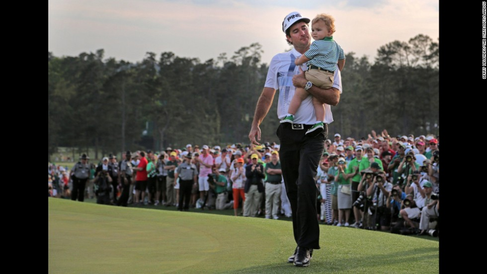 Pro golfer Bubba Watson holds his son, Caleb, after winning the Masters tournament on Sunday, April 13, in Augusta, Georgia. It was the second Masters win for Watson, who also won the major in 2012.