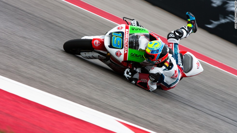 Xavier Simeon slides on his motorcycle during a turn at the Moto2 race in Austin, Texas, on Sunday, April 13. Simeon crashed and didn't finish the race, which was won by Maverick Vinales.