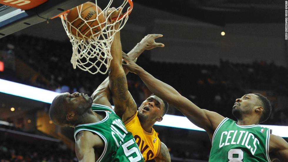 Cleveland forward Alonzo Gee dunks on Boston center Joel Anthony during an NBA basketball game Saturday, April 12, in Cleveland. The Celtics won the game 111-99.