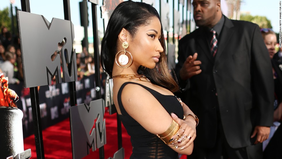 Nicki Minaj leaves the colorful accoutrements at home for the 2014 MTV Movie Awards on April 13.