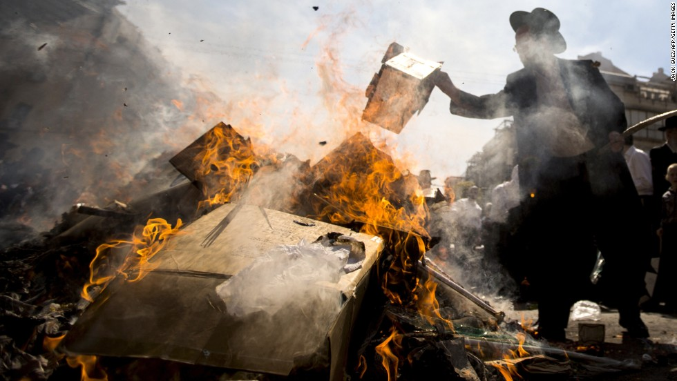 Ultraorthodox Jews burn leavened items in a final preparation before the start at sundown of the Jewish Passover holiday, in the city of Bnei Brak, central Israel, on Monday, April 14.  All leavened food, such as bread, is forbidden to Jews during the weeklong holiday, which commemorates the Israelites' exodus from Egypt some 3,500 years ago. Because of the haste with which the Jews left Egypt, the bread they had prepared for the journey did not have time to rise. To honor their ancestors' plight, the religious avoid eating leavened food products throughout Passover.