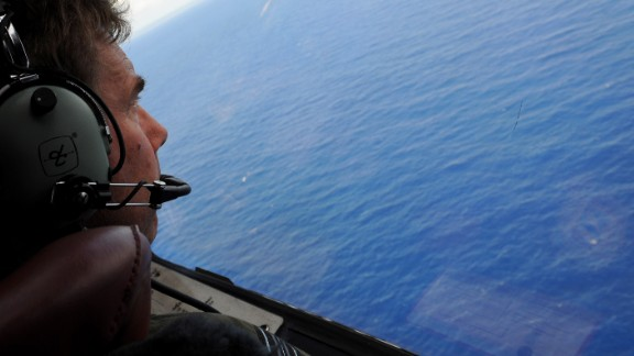 IN FLIGHT - APRIL 11: Co-pilot and Squadron Leader Brett McKenzie of the Royal New Zealand Airforce (RNZAF) P-3K2-Orion aircraft, helps to look for objects during the search for missing Malaysia Airlines flight MH370 in flight over the Indian Ocean on April 13, 2014 off the coast of Perth, Australia. Search and rescue officials in Australia are confident they know the approximate position of the black box recorders from missing Malaysia Airlines Flight MH370, Australian Prime Minister Tony Abbott said on Friday. At the same time, however, the head of the agency coordinating the search said that the latest