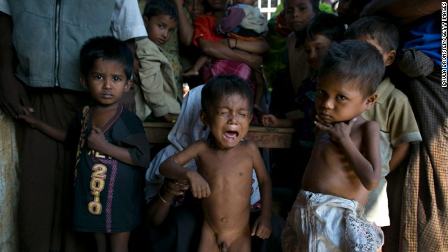 Rohingya children displaced by violence wait for medical care at a camp in Rakhine.