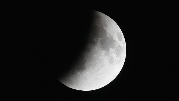 Dust and sulfur dioxide in the Earth's atmosphere can affect the size of the shadow spreading across the moon's surface.