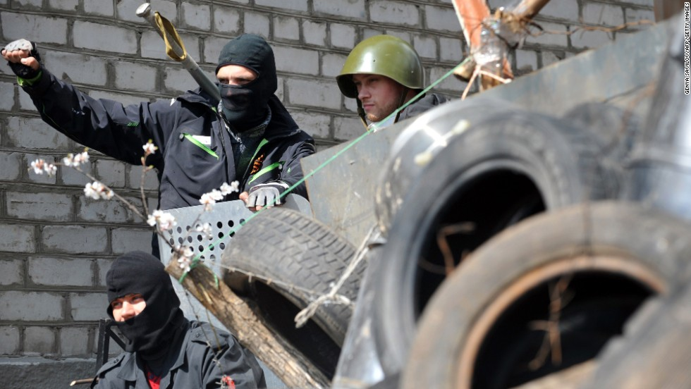 Pro-Russian activists guard a barricade April 15 outside the regional police building that they seized in Slovyansk.
