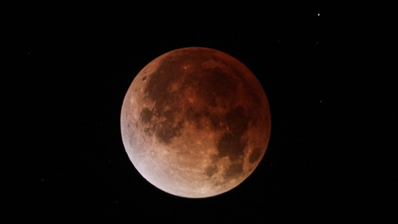 Jeffrey Root shot this photo of the April 15 blood moon through a telescope in Salt Lake City.