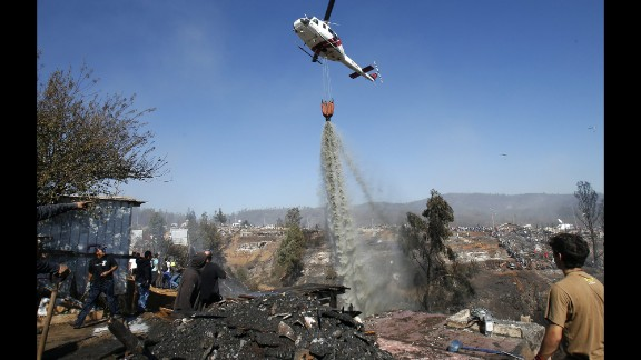 A helicopter releases water over Ramaditas Hill in Valparaiso on Monday, April 14.