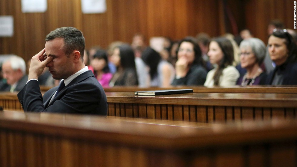 Pistorius rubs his eye Tuesday, April 15, after testifying during his murder trial.