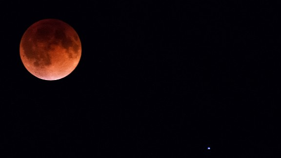 """Kyle Hansen stood outside for an hour in 25-degree weather on April 15 to get this shot of the blood moon over Burnsville, Minnesota. He said it was """"very cool to see the shadow of the earth on the moon."""""""