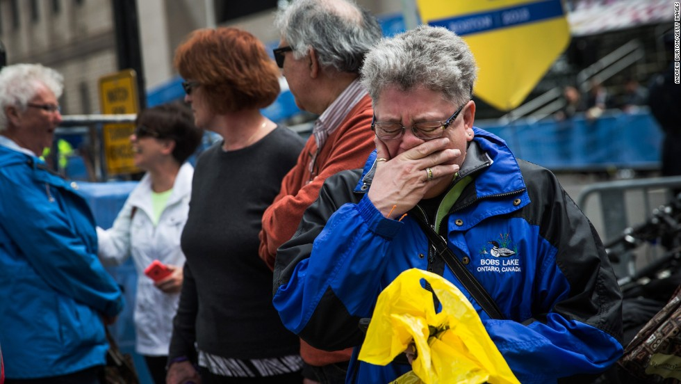 Sharon Neary, of Rochester, New York, cries while watching Tuesday's ceremony in Boston.