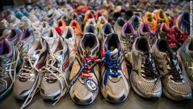 "BOSTON, MA - APRIL 14:  Runner's shoes are laid out in a display titled, ""Dear Boston: Messages from the Marathon Memorial"" in the Boston Public Library to commemorate the 2013 Boston Maraton bombings, on April 14, 2014 in Boston, Massachusetts. Last year, two pressure cooker bombs killed three and injured an estimated 264 others during the Boston marathon, on April 15, 2013.  (Photo by Andrew Burton/Getty Images)"