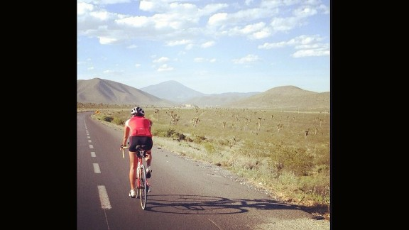 """After finishing her swim, Bastidas jumped on her bike to travel more than 2,900 miles from Cancun to Atlanta. """"You're only as strong as your greatest accomplishment,"""" she says."""