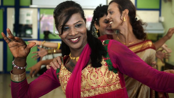 """An Indian transgender resident dances with others at an event to celebrate the Supreme Court judgement in Mumbai recognizing the """"third-gender""""."""