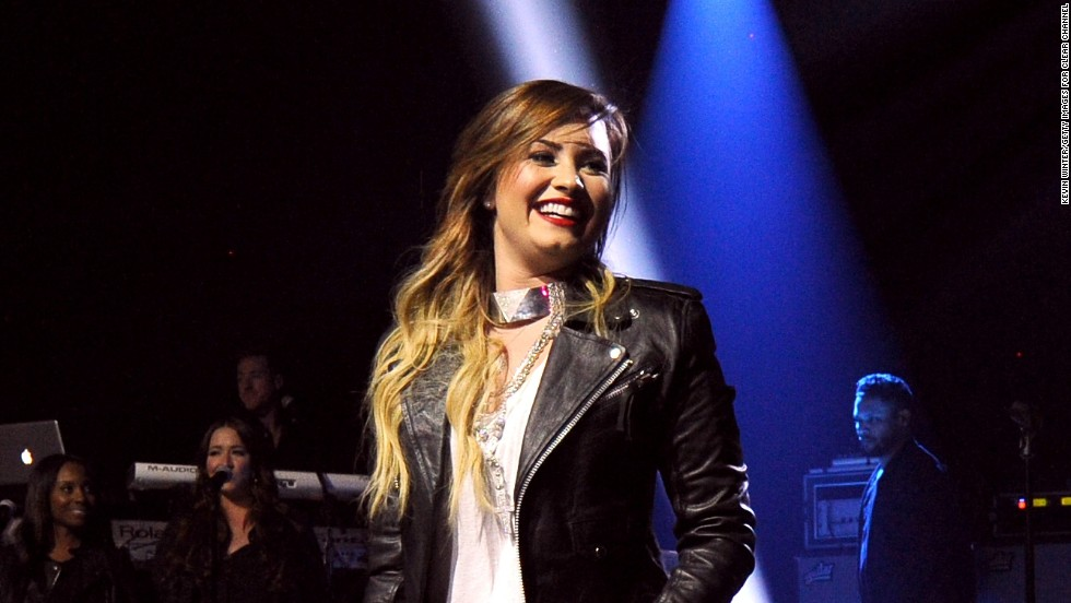 Demi Lovato soaks in the experience during her performance at iHeart Radio Theater in California on April 14.
