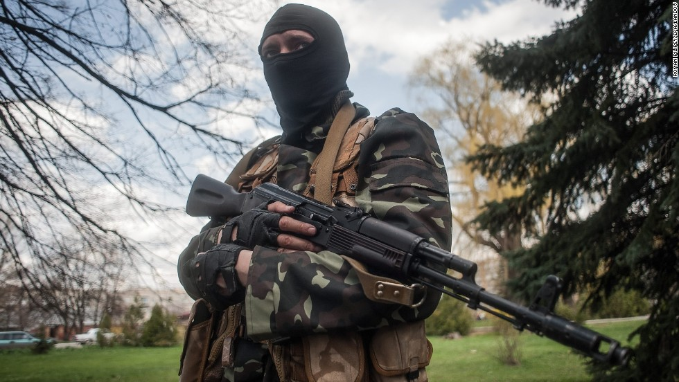A masked gunman stands guard near tanks in Slovyansk on Wednesday, April 16.