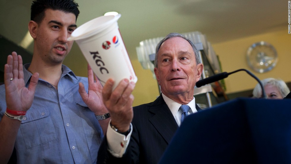 Bloomberg holds a large cup as he speaks to the media about the health impacts of sugar in March 2013.