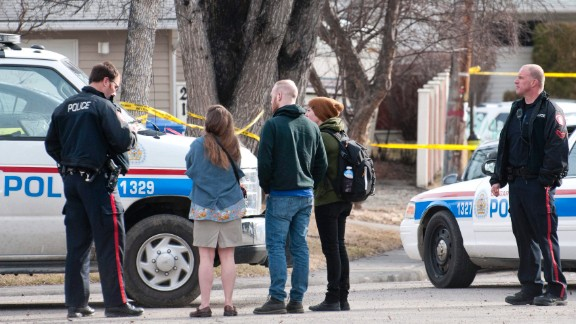 Calgary police talk to potential witnesses for statements.