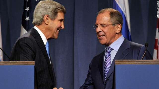 John Kerry (L) and Russian Foreign Minister Sergey Lavrov shake hands as they speak to the press at the Hotel Intercontinental on September 12, 2013 in Geneva, Switzerland.