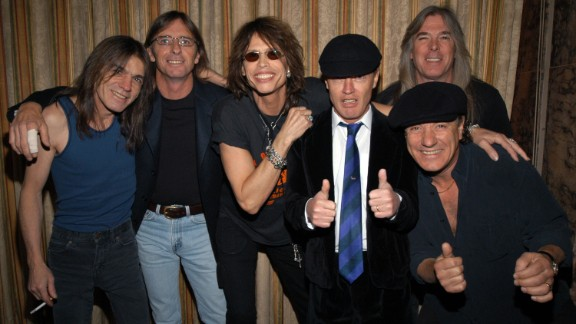 Steven Tyler of Aerosmith, center, poses with AC/DC at the Rock and Roll Hall of Fame induction ceremony in 2003.