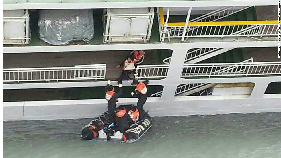 A passenger is helped onto a rescue boat on April 16.