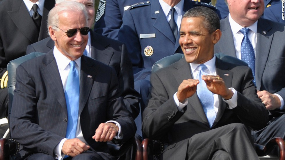 Biden sits with Obama during a ceremony in Arlington, Virginia, in September 2011.