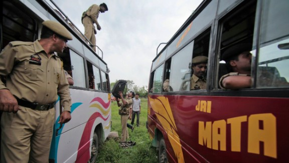 Security personnel load their luggage on a bus as they leave for various polling centers in Udhampur, India, on Tuesday, April 15.