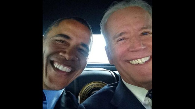 President Barack Obama and Vice president Joe Biden pose for a selfie.