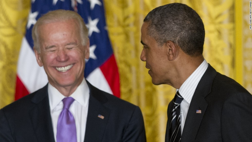Biden laughs at the White House in June 2013.