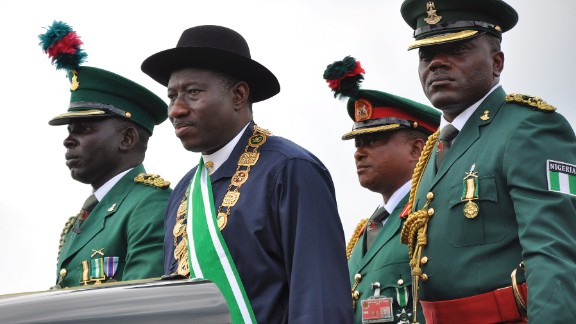 Nigerian President Goodluck Jonathan, second from left, stands on the back of a vehicle after being sworn-in as President during a ceremony in the capital of Abuja on May 29, 2011. In December 2011, Jonathan declared a state of emergency in parts of the country afflicted by violence from Boko Haram.