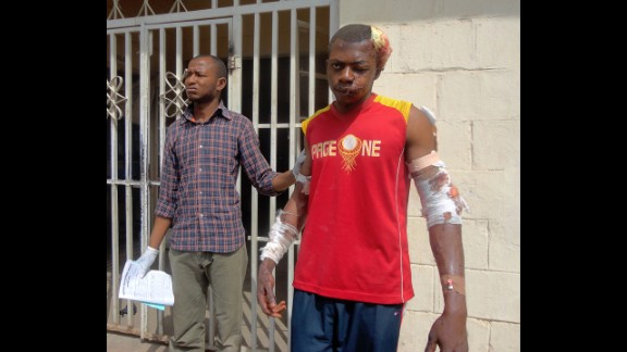 A paramedic helps a young man as he leaves a hospital in the northern Nigerian city of Kano on January 21, 2012. A spate of bombings and shootings left more than 200 people dead in Nigeria