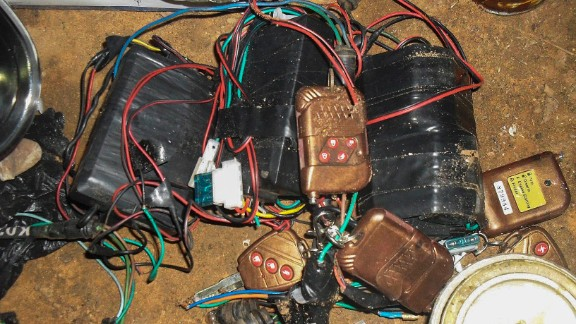 A photograph made available by the Nigerian army on August 13, 2013, shows improvised explosive devices, bomb-making materials and detonators seized from a Boko Haram hideout. Gunmen attacked a mosque in Nigeria with automatic weapons on August 11, 2013, killing at least 44 people.