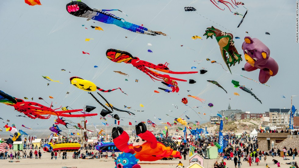 People fly kites in Berck-sur-Mer, France, during the 28th International Kite Meeting on Saturday, April 12. The event takes place through April 21.