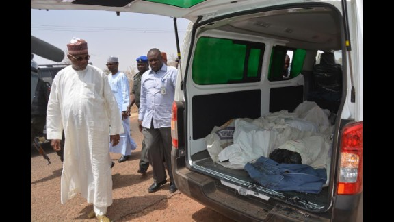 Yobe state Gov. Ibrahim Gaidam, left, looks at the bodies of students inside an ambulance outside a mosque in Damaturu. At least 29 students died in an attack on a federal college in Buni Yadi, near the capital of Yobe state, Nigeria's military said on February 26, 2014. Authorities suspect Boko Haram carried out the assault in which several buildings were also torched.