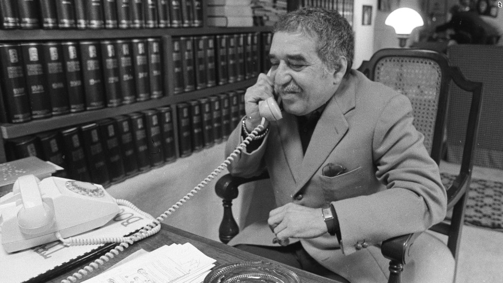 "García Márquez, a native of Colombia, talks on the phone at his home in 1982. He is widely credited with helping to popularize the ""magical realism"" genre."