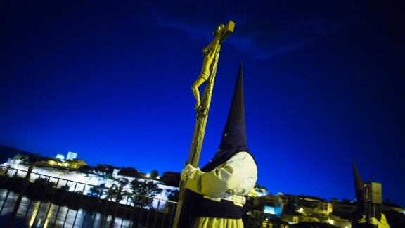 Penitents from Jesus del Via Crucis brotherhood cross a bridge as they take part in a procession in Zamora, Spain, on April 15.