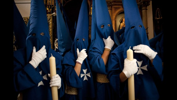 Penitents take part in the Fusionadas brotherhood procession in Malaga, Spain, on April 16.