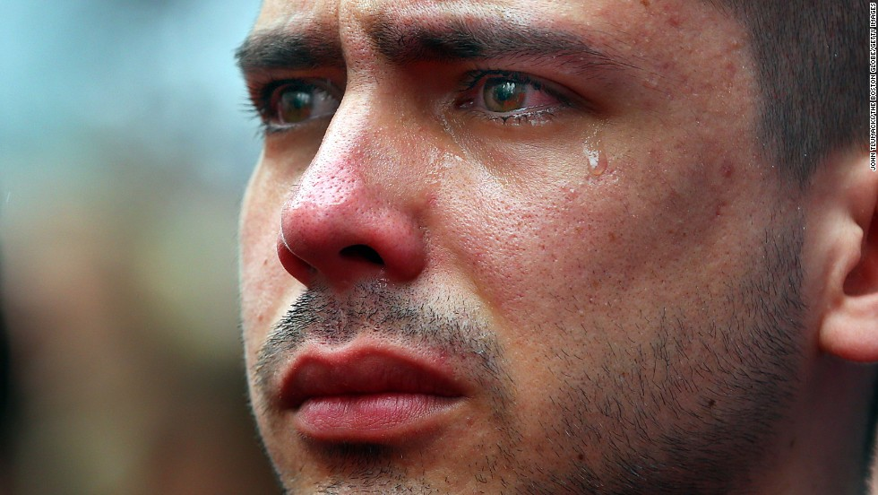 "Boston University student Sebastian Filgueira-Gomez has tears in his eyes during a moment of silence held Tuesday, April 15, on the <a href=""http://www.cnn.com/2014/04/15/us/gallery/boston-bombing-memorial/index.html"">one-year anniversary of the Boston Marathon bombings</a>. Filgueira-Gomez was standing on Boston's Boylston Street, a block from the marathon's finish line."